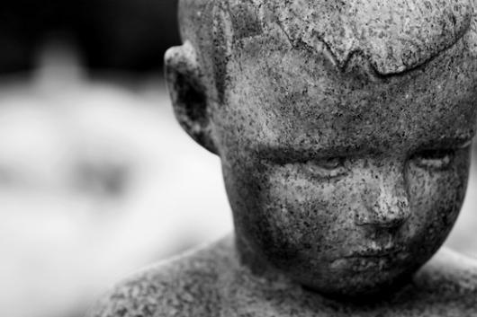 boy-statue-regret