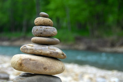 stacked-stones-by-river